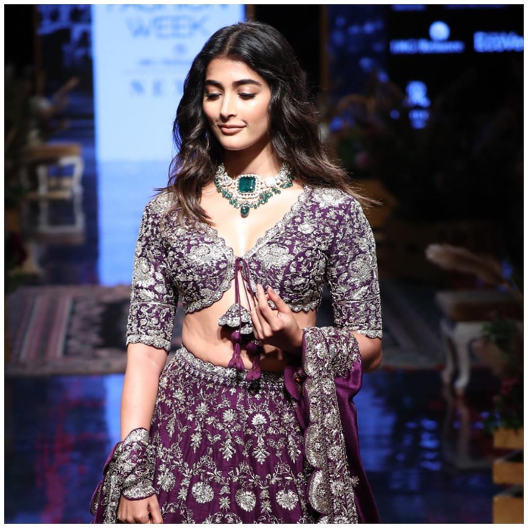 Pooja hegde with emerald necklace