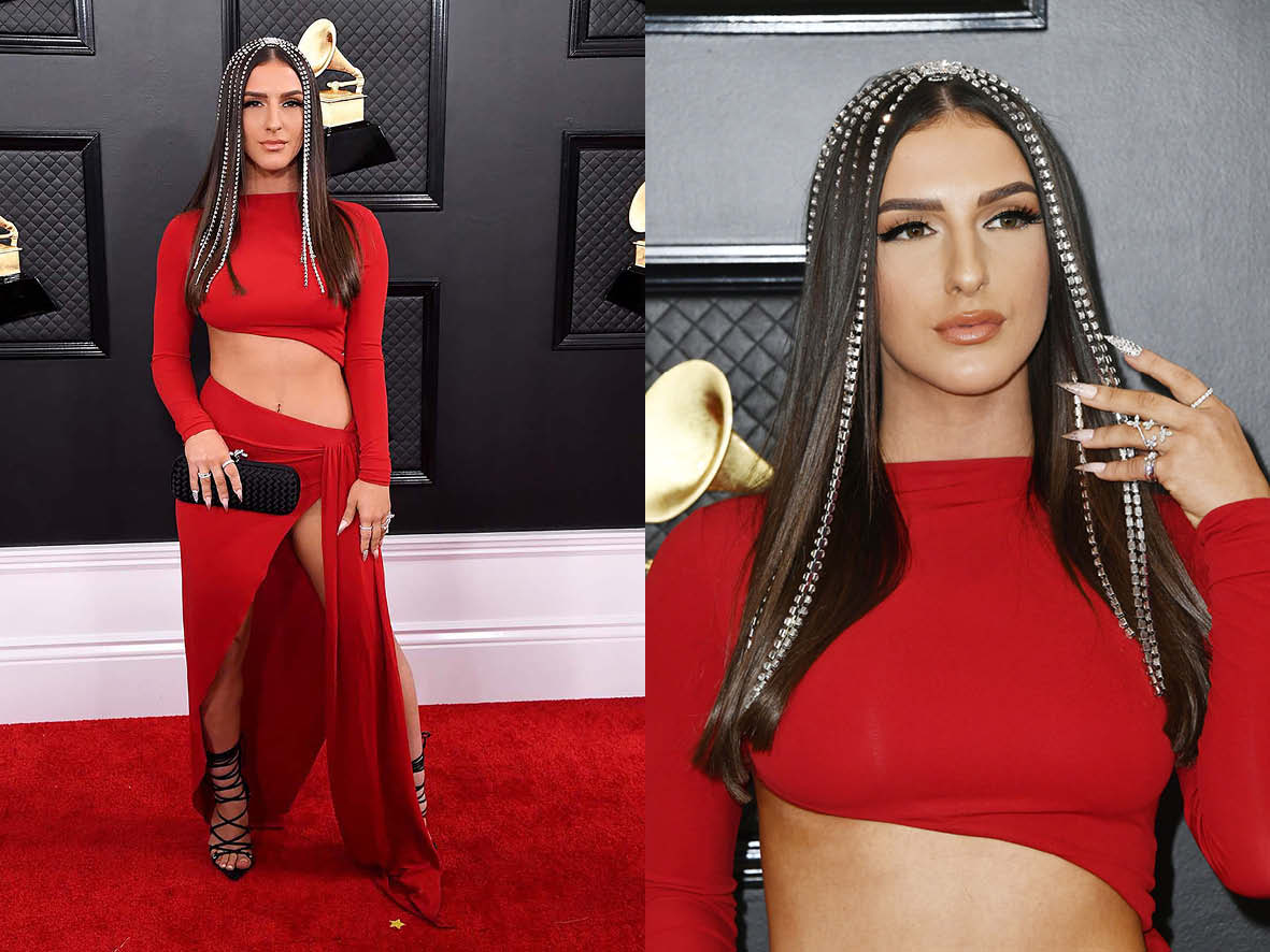 NJOMZA seen her hair with long strands of jewellery