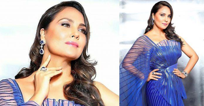 Lara Dutta wearing sapphire danglers